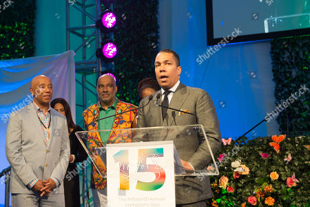 Stock Image of Valentino D. Carlotti speaks on stage at the Rush Philanthropic Arts Foundation's 15th Annual Art for Life Benefit at Fairview Farms in Water Mill, in New York
