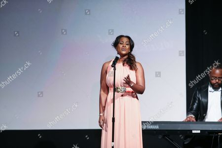 Stock Image of Angie Fisher performs on stage during the Black Aids Institute's 16th Annual Heroes in the Struggle Gala held at the Directors Guild of America, in Los Angeles