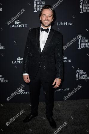 Stock Image of Darren McMullen arrives at the 16th Costume Designer Guild Awards,, in Beverly Hills, Calif