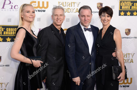 From left, Jessica Steele, Chris Sanders, Kirk DeMicco, and Kacy DeMicco arrive at the 19th annual Critics' Choice Movie Awards at the Barker Hangar, in Santa Monica, Calif