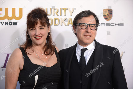 Stock Image of Janet Grillo, left, and David O. Russell arrive at the 19th annual Critics' Choice Movie Awards at the Barker Hangar, in Santa Monica, Calif