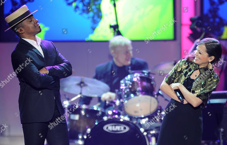 Natalia Lafourcade, right, and Alexandre Pires perform at the 2012 Latin Recording Academy Person of the Year Tribute to Caetano Veloso at the MGM Grand Garden Arena, in Las Vegas