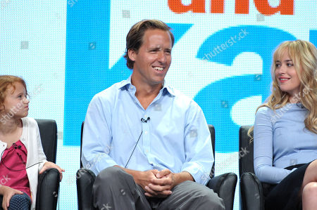"""Actress Maggie Elizabeth Jones, left, Actor Nat Faxon, and Actress Dakota Johnson appear on stage at the FOX TCA panel for """"Ben And Kate"""" at the Beverly Hilton hotel, in Beverly Hills, Calif"""