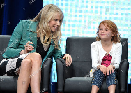 """Actress Lucy Punch, left, and Actress Maggie Elizabeth Jones appear on stage at the FOX TCA panel for """"Ben And Kate"""" at the Beverly Hilton hotel, in Beverly Hills, Calif"""