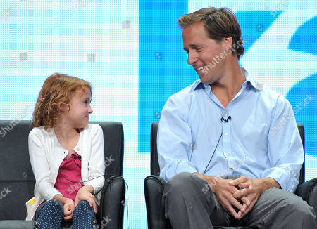 """Actress Maggie Elizabeth Jones, left, and actor Nat Faxon appear on stage at the FOX TCA panel for """"Ben And Kate"""" at the Beverly Hilton hotel, in Beverly Hills, Calif"""