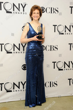 Natasha Katz poses with her Best Lighting of a Musical award in the press room at the 66th annual Tony Awards, in New York