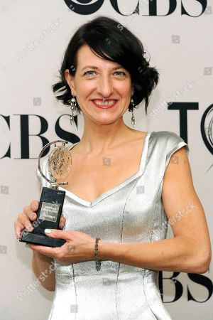 """Donyale Werle poses with the Tony Award for best scenic design of a play for her work on """"Peter and the Starcatcher,"""" at the 66th annual Tony Awards, in New York"""
