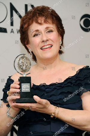 Judy Kaye poses with her award at the 66th annual Tony Awards, in New York