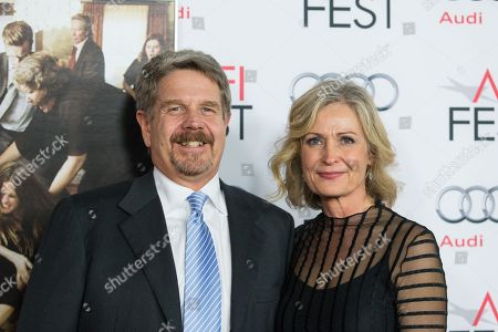 """Director John Wells (L) and wife Marilyn Wells arrive at the 2013 AFI Fest screening of """"August: Osage County"""" at the TCL Chinese Theatre on in Los Angeles"""