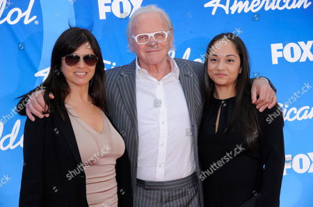 "Anthony Hopkins, center, and from left, Stella Arroyave and a guest arrive at the ""American Idol"" finale at the Nokia Theatre at L.A. Live, in Los Angeles"