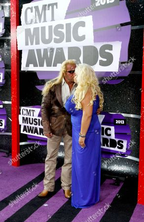 Duane Lee Chapman, left, and Beth Chapman arrive at the 2013 CMT Music Awards at Bridgestone Arena, in Nashville, Tenn