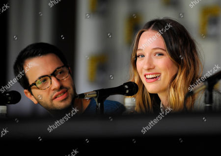 """Sophie Lowe, right, speaks as Edward Kitsis, left, looks on at the """"Once Upon Time in Wonderland"""" panel on Day 4 of the 2013 Comic-Con International Convention on in San Diego"""