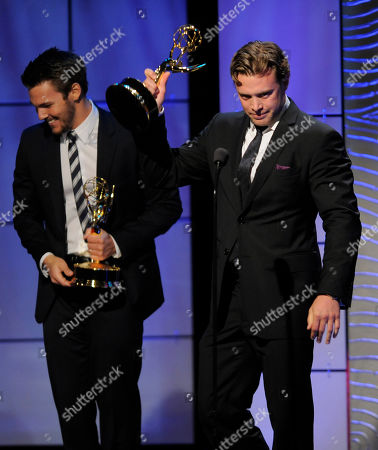 """Billy Miller, right, accepts the award for outstanding supporting actor in a drama series for """"The Young and the Restless"""" at the 40th Annual Daytime Emmy Awards, in Beverly Hills, Calif. In background is co-winner Scott Clifton from the cast of """"The Bold and the Beautiful"""