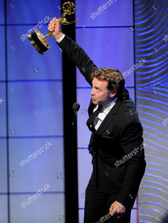 """Billy Miller accepts the award for outstanding supporting actor in a drama series for """"The Young and the Restless"""" at the 40th Annual Daytime Emmy Awards, in Beverly Hills, Calif"""