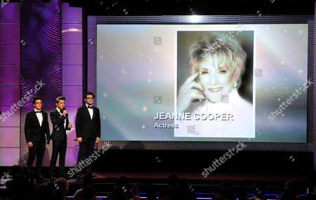 From left, Piero Barone, Gianluca Ginoble and Ignazio Boschetto, of musical group Il Volo, perform during an in memoriam tribute at the 40th Annual Daytime Emmy Awards, in Beverly Hills, Calif. Pictured on screen is Jeanne Cooper