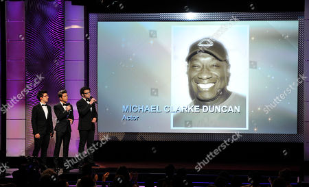 From left, Piero Barone, Gianluca Ginoble and Ignazio Boschetto, of musical group Il Volo, perform during an in memoriam tribute at the 40th Annual Daytime Emmy Awards, in Beverly Hills, Calif. Pictured on screen is Michael Clarke Duncan