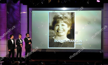 Stock Image of From left, Piero Barone, Gianluca Ginoble and Ignazio Boschetto, of musical group Il Volo, perform during an in memoriam tribute at the 40th Annual Daytime Emmy Awards, in Beverly Hills, Calif. Pictured on screen is Bonnie Franklin