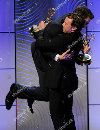 """Scott Clifton, left, from the cast of """"The Bold and the Beautiful,"""" congratulates co-winner Billy Miller, from the cast of """"The Young and the Restless,"""" as they accept the award for outstanding supporting actor in a drama series at the 40th Annual Daytime Emmy Awards, in Beverly Hills, Calif. In background is co-winner Scott Clifton"""