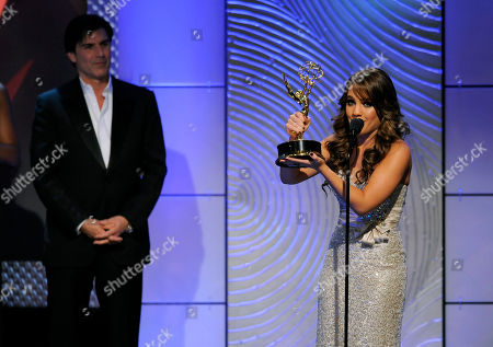 "Kristen Alderson accepts the award for outstanding younger actress in a drama series for ""General Hospital"" at the 40th Annual Daytime Emmy Awards, in Beverly Hills, Calif. Looking on at right is presenter Vincent Irizarry"