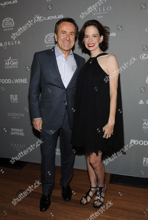 FOOD & WINE's editor in chief Dana Cowin, right, poses with chef Daniel Boulud at the 2013 FOOD & WINE Best New Chefs 25th anniversary celebration at Pranna in New York
