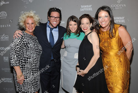 FOOD & WINE's Gail Simmons, center, editor in chief Dana Cowin, second right, and publisher Christina Grdovic, right, pose with celebrity chefs Anne Burrell, left, and Scott Conant at the 2013 FOOD & WINE Best New Chefs 25th anniversary celebration at Pranna in New York