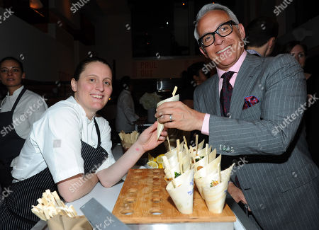 Chef Geoffrey Zakarian takes a dish from Best New Chef alum April Bloomfield at the 2013 FOOD & WINE Best New Chefs 25th anniversary celebration at Pranna in New York