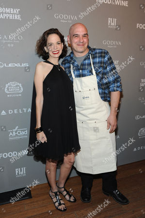 FOOD & WINE's editor in chief Dana Cowin, left, poses with chef Michael Symon, of ABC's The Chew, at the 2013 FOOD & WINE Best New Chefs 25th anniversary celebration at Pranna in New York