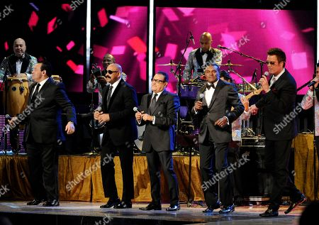 Salsa Giants perform the closing act at the 14th Annual Latin Grammy Awards at the Mandalay Bay Hotel and Casino, in Las Vegas. From left, Tito Nieves, Oscar D' Leon, Ismael Miranda, Jose Alberto, El Canario, and Willy Chirino