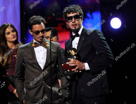 Emmanuel Horvilleur, left, and Dante Spinetta, of the musical group Illya Kuryaki and the Valderramas, accept the award for best urban song at the 14th Annual Latin Grammy Awards at the Mandalay Bay Hotel and Casino, in Las Vegas