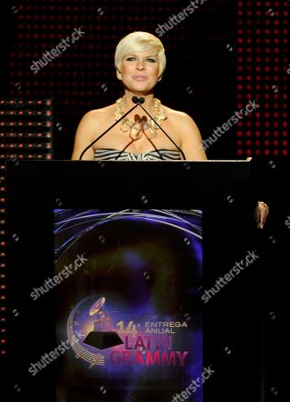 Presenter Pasion Vega speaks on stage at the 14th Annual Latin Grammy Awards at the Mandalay Bay Hotel and Casino, in Las Vegas
