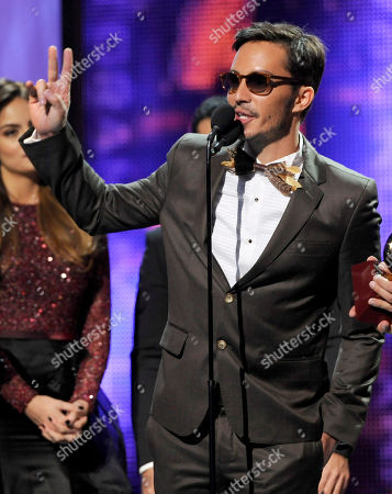Emmanuel Horvilleur, left, of the musical group Illya Kuryaki and the Valderramas, accepts the award for best urban song at the 14th Annual Latin Grammy Awards at the Mandalay Bay Hotel and Casino, in Las Vegas