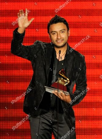 "Alex Campos accepts the award for best christina album (Spanish language) for ""Regreso a Ti"" at the 14th Annual Latin Grammy Awards at the Mandalay Bay Hotel and Casino, in Las Vegas"