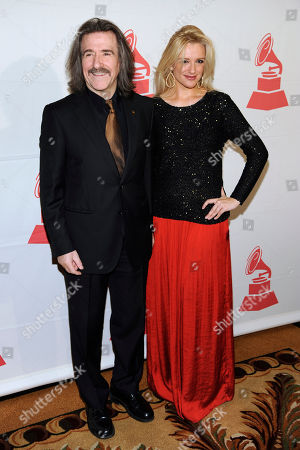 Stock Picture of Latin Recording Academy Chairman of the Board of Trustees Luis Cobos, left, and Patricia Cobos, arrive at the Latin Recording Academy Lifetime Achievement and Trustees awards, at the Four Seasons Hotel in Las Vegas