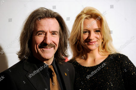 Latin Recording Academy Chairman of the Board of Trustees Luis Cobos, left, and Patricia Cobos, arrive at the Latin Recording Academy Lifetime Achievement and Trustees awards, at the Four Seasons Hotel in Las Vegas