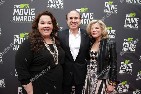 Melissa McCarthy, Viacom's Philippe Dauman and wife Deborah Dauman arrive at the MTV Movie Awards in Sony Pictures Studio Lot in Culver City, Calif., on