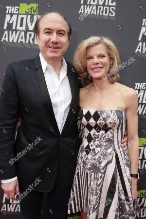 Viacom's Philippe Dauman and wife Deborah Dauman arrive at the MTV Movie Awards in Sony Pictures Studio Lot in Culver City, Calif., on