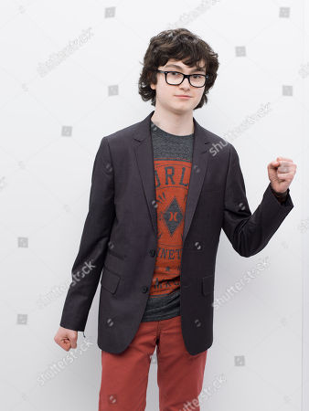 Stock Image of Jared Gilman poses for a photo at the 2013 MTV Movie Awards at Sony Studios on in Los Angeles, Ca