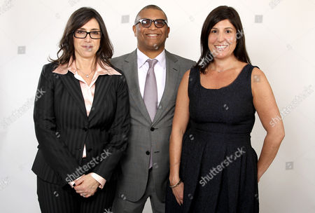 Stock Photo of Oscar nominees Stacey Sher, left, Reginald Hudlin, center, and Pilar Savone pose for a portrait at the 2013 Oscar Nominee Luncheon, in Los Angeles