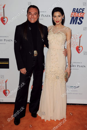 """Nick Chavez, left, and Rebecca Da Costa arrive at the 20th annual Race to Erase MS event """"Love to Erase MS"""" at the Hyatt Regency Century Plaza, in Los Angeles"""