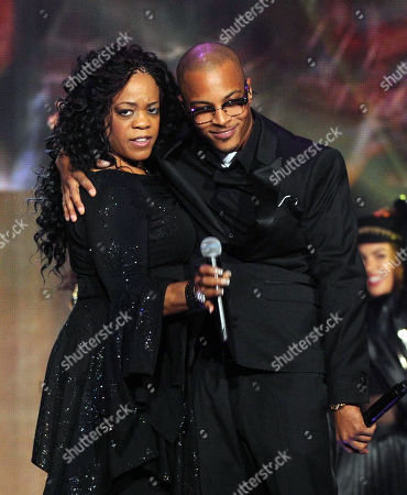 Stock Photo of Evelyn 'Champagne' King, left, and T.I. perform onstage at the 2013 Soul Train Awards at the Orleans Arena on in Las Vegas