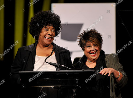 Singers Merry Clayton, left, and Tata Vega speak onstage at the 2014 AARP's Movies for Grownups Gala, on Monday, Feb. 10th, 2014 in Beverly Hills, Calif