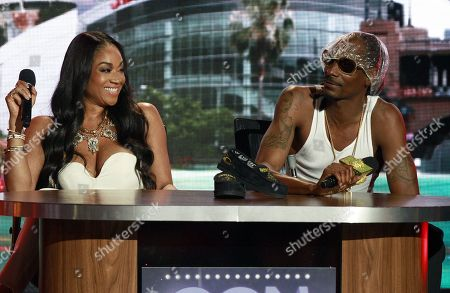 Reality personality Mimi Faust and rapper Uncle Snoop onstage at the 2014 BET Hip Hop Awards held at the Atlanta Civic Center, in Atlanta