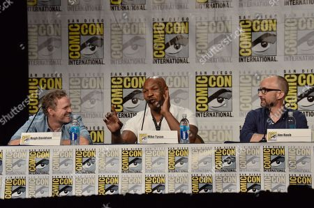 """Hugh Davidson, and from left, Mike Tyson and Jim Rash attend the """"Mike Tyson Mysteries"""" panel on Day 2 of Comic-Con International, in San Diego"""