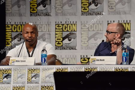"""Mike Tyson, left, and Jim Rash attend the """"Mike Tyson Mysteries"""" panel on Day 2 of Comic-Con International, in San Diego"""