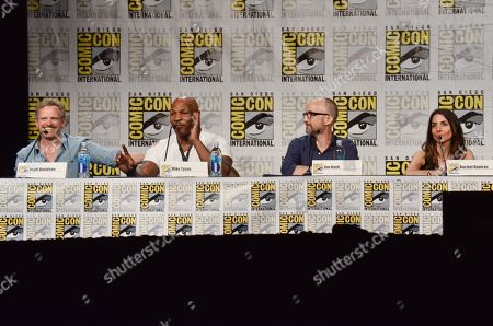 """Hugh Davidson, and from left, Mike Tyson, Jim Rash and Rachel Ramras attend the """"Mike Tyson Mysteries"""" panel on Day 2 of Comic-Con International, in San Diego"""