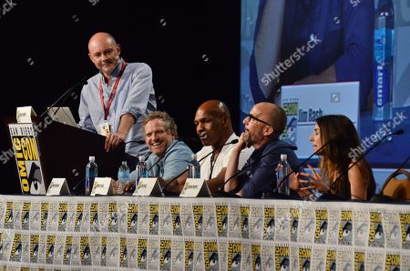"""Rob Corddry, and from left, Hugh Davidson, Mike Tyson, Jim Rash and Rachel Ramras attend the """"Mike Tyson Mysteries"""" panel on Day 2 of Comic-Con International, in San Diego"""