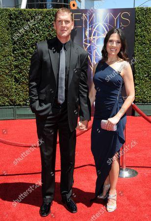 Regan Burns, left, and Jennifer Burns arrive at the 2014 Creative Arts Emmys at Nokia Theatre L.A. LIVE, in Los Angeles