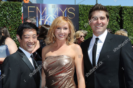 Stock Picture of From left, Grant Imahara, Kari Byron, and Tory Belleci arrive at the 2014 Creative Arts Emmys at Nokia Theatre L.A. LIVE, in Los Angeles