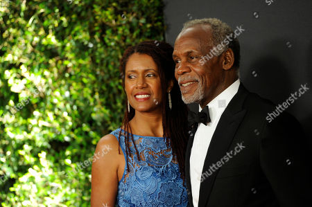 Eliane Cavalleiro, left, and Danny Glover arrive at the 6th annual Governors Awards at the Hollywood and Highland Center on in Los Angeles