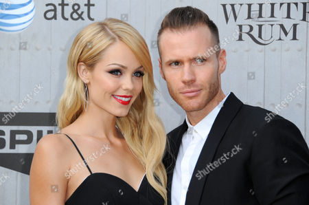 Laura Vandervoort, left, and Oliver Trevena arrive at the Guys Choice Awards at Sony Pictures Studios, in Culver City, Calif